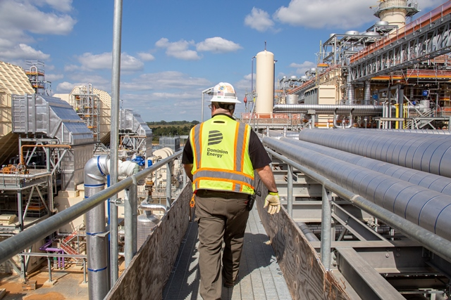 A Dominion Energy employee surveys the Greensville County Power Station which began commercial operations on Saturday, Dec. 8.
